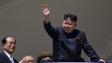 North Korean leader Kim Jong Un waves from a balcony at the end of a mass military parade in Pyongyang in 2012.