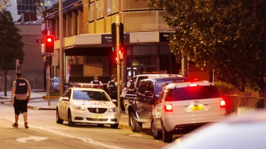 Police cars block the area around Charles and Hassall Streets in Parramatta.