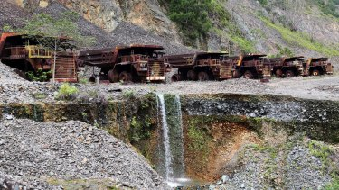 Heavy trucks sit rusting on the edges of Panguna copper mine, closed in 1989 as a result of sabotage.