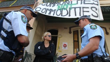 """""""A farce"""": Tayce, 27, speaks with police in Millers Point."""