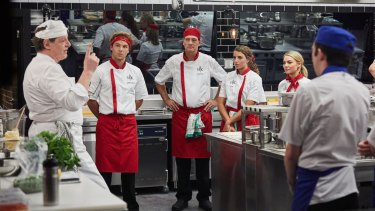Pierre White addresses the celebrity contestants before they serve customers.