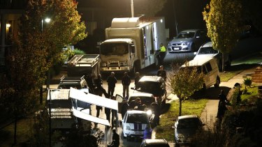 Police outside the property in Greenvale on Friday night.