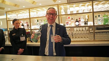 Qantas chief executive Alan Joyce serves Green Ant gin, made in the Northern Territory, at the launch of the airline's first London lounge.