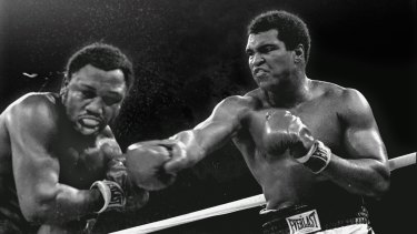 A hero to millions: Ali connects with a right against challenger Joe Frazier during their title fight in Manila.