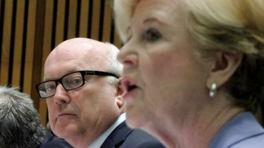 Attorney-General Senator George Brandis and Professor Gillian Triggs, President of the Human Rights Commission.