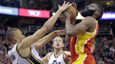 Boom or bust: Utah Jazz rookie Dante Exum defends against Houston Rockets guard James Harden as Joe Ingles looks on.