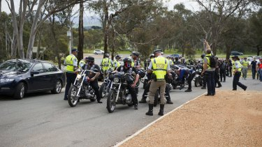 Rebels bikies are stopped by police at the intersection of Victoria Street and the Barton Highway at Hall in Canberra last October.