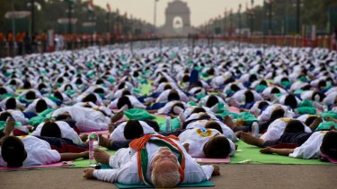 Indian Prime Minister Narendra Modi performs yoga along with thousands of Indians  in New Delhi.
