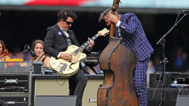 The Living End's Chris Cheney and Scott Owen performing at last year's AFL Grand Final.