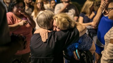 Greg Abbott consoles Ann Montgomery, a Sunday school teacher at First Baptist Church in Sutherland Springs during a candlelight vigil for the victims of the fatal shooting.