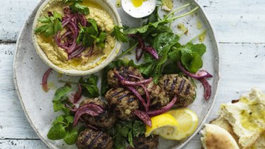 Lamb meatballs with onion salad and hummus.