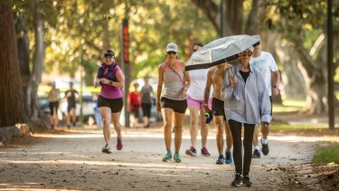 Melburnians got their exercise in early at the Tan before the temperature soared into the 30s.