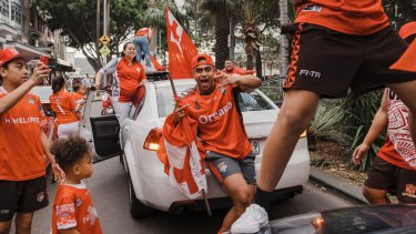 Tongan pride: Supporters of the Mate Ma'a hit the streets at Manly Corso after their win over Lebanon.