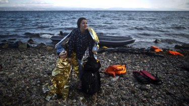 A Syrian woman and her child arrive on the Greek island of Lesbos after a perilous sea crossing from the Turkish coast in October last year.