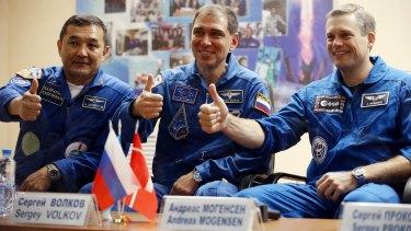 From left: Kazakhstan's cosmonaut Aydyn Aimbetov, Russian cosmonaut Sergei Volkov and Denmark's astronaut Andreas Mogensen on Tuesday.