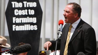 Senator Barnaby Joyce speaks to Australian farmers who marched to Parliament House in Canberra in a protest on January 4, 2010.