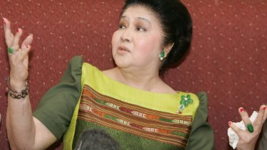 Former Filipino first lady Imelda Marcos gestures following her acquittal on corruption charges in 2008.