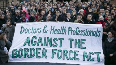 Doctors and Health Professionals protesting new laws that threaten them with jail if they reveal conditions in detention centres.