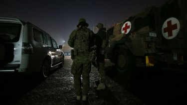 Australian Army medics wait for the order to move out.