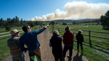 Locals watch helicopters attacking the Lancefield fire in Syd Smith's lane across the gully.