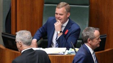 Opposition Leader Bill Shorten passes Prime Minister Malcolm Turnbull to vote against the plebiscite bill on Thursday.