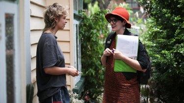 Amy MacMahon (right) doorknocking in her electorate.