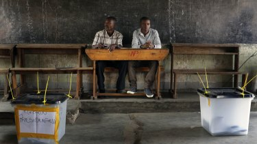 Election observers sit in an empty polling station in Bujumbura.