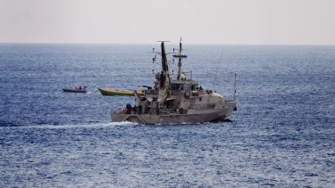 An Australian Navy vessel approaches a suspected refugee boat off the coast of Christmas Island last week.