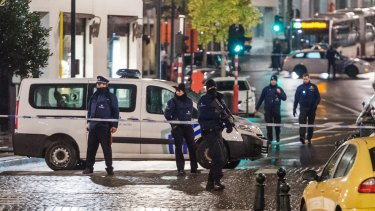 Lockdown in the streets, humour in the tweets: Belgian authorities conducted 22 anti-terror raids on Sunday, arresting 16.