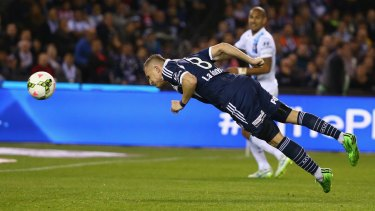 Victory's Besart Berisha heads home to open the scoring for Melbourne Victory against Melbourne City on Friday.