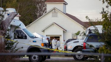 Investigators work at the scene of the deadly shooting at the First Baptist Church in Sutherland Springs, Texas.
