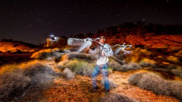 Ecologist Steve Murphy among the spinifex, searching for the elusive night parrot's call.