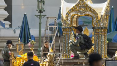 Police investigate the scene around the Erawan Shrine the morning after the explosion in Bangkok.