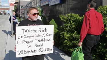 The suspected assailant, James Hodgkinson, pictured in 2012 protesting outside of the United States Post Office in Downtown Belleville, Ill.