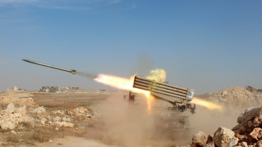 Syrian rebels launch missiles against Syrian government forces near Aleppo.