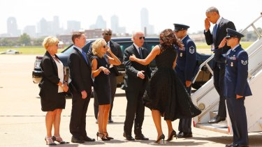 President Barack Obama, right, and first lady Michelle Obama are greeted by local officials in Dallas. The Obamas were joined by Vice-President Joe Biden and his wife Jill Biden.