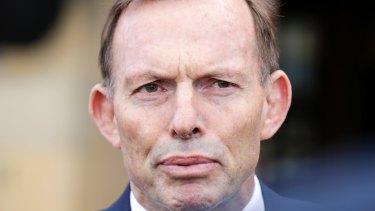 Former prime minister Tony Abbott addresses the media in Hobart on Friday.