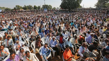 People listen to Rahul Gandhi during an election rally near Bayad in Gujarat state in November.