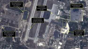 A satellite image shows Russian transport aircraft, helicopters, tanks, trucks and armed personnel carriers at an air base in Latakia in Syria.