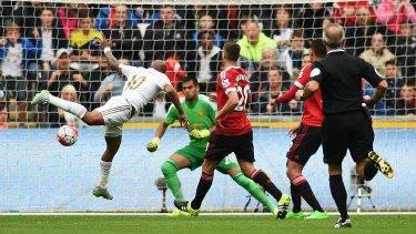 Andre Ayew scores for Swansea at Liberty Stadium on Sunday.
