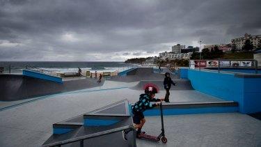 Bondi's skate park is almost deserted amid the gloom on Saturday.