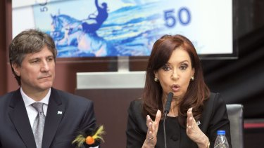 Argentina's President Cristina Fernandez speaks next to Vice-President Amado Boudou during a ceremony at Casa Rosada presidential palace last year on the 32th anniversary of the start of the Falklands War.