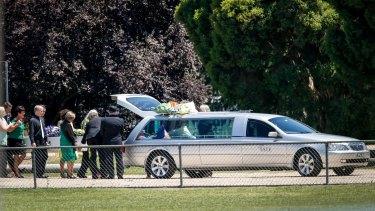 Karen Chetcuti's coffin is loaded into the hearse.