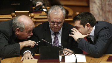 Interior Minister Nikos Voutsis, left, Deputy Prime Minister Giannis Dragasakis, centre,  and Prime Minister Alexis Tsipras, right, are yet to win over eurozone leaders with their policies.