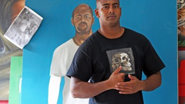 """Myuran Sukumaran, in front of a self-portrait, has improved rapidly.  """"Every visit ... I find he's made more remarkable progress,'' Ben Quilty says."""