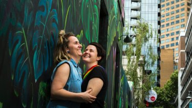 Zoe McDonald and Katie Larsen celebrate the vote at the State Library in Melbourne.