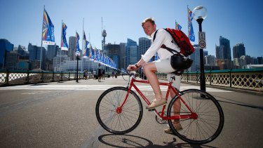 Micheal Stoddart on his bike on Sydney's Pyrmont Bridge.