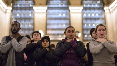Protesters observe a moment of silence in a chokehold gesture at a protest in New York last year.