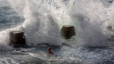 Rough seas pummel swimmers at Coogee Beach on Sunday.