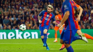 Messi scores his side's third goal.